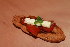 Feta cheese and mixed tomatoes on crispy brown bread canape