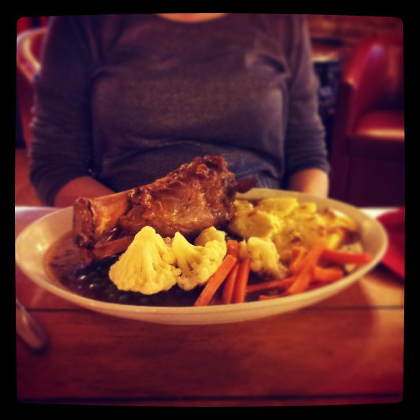 Pork shank with apple and cider sauce and dauphinoise potatoes, at The Rat Trap Inn, Usk, Wales