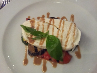 Buffalo mozzarella on a bed of chargrilled vegetables with balsamic and basil reduction, at Caravaggio, London