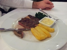 Medium-rare steak with door-stop chips, at Caravaggio, London